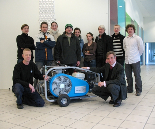 Staff and students with the new compressor